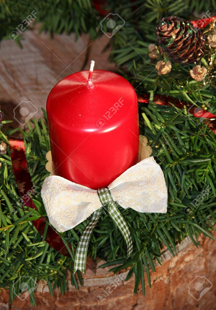 Christmas Decoration With Red Candle And Jew Branches On Tree ...