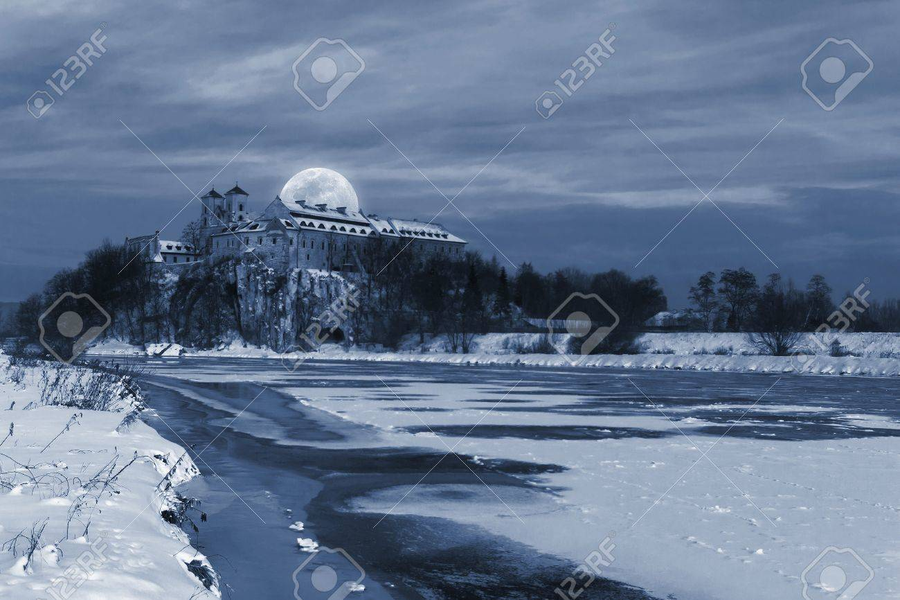 Big moon over the Benedictine Abbey  in Tyniec, near Krakow - winter view Stock Photo - 17969636