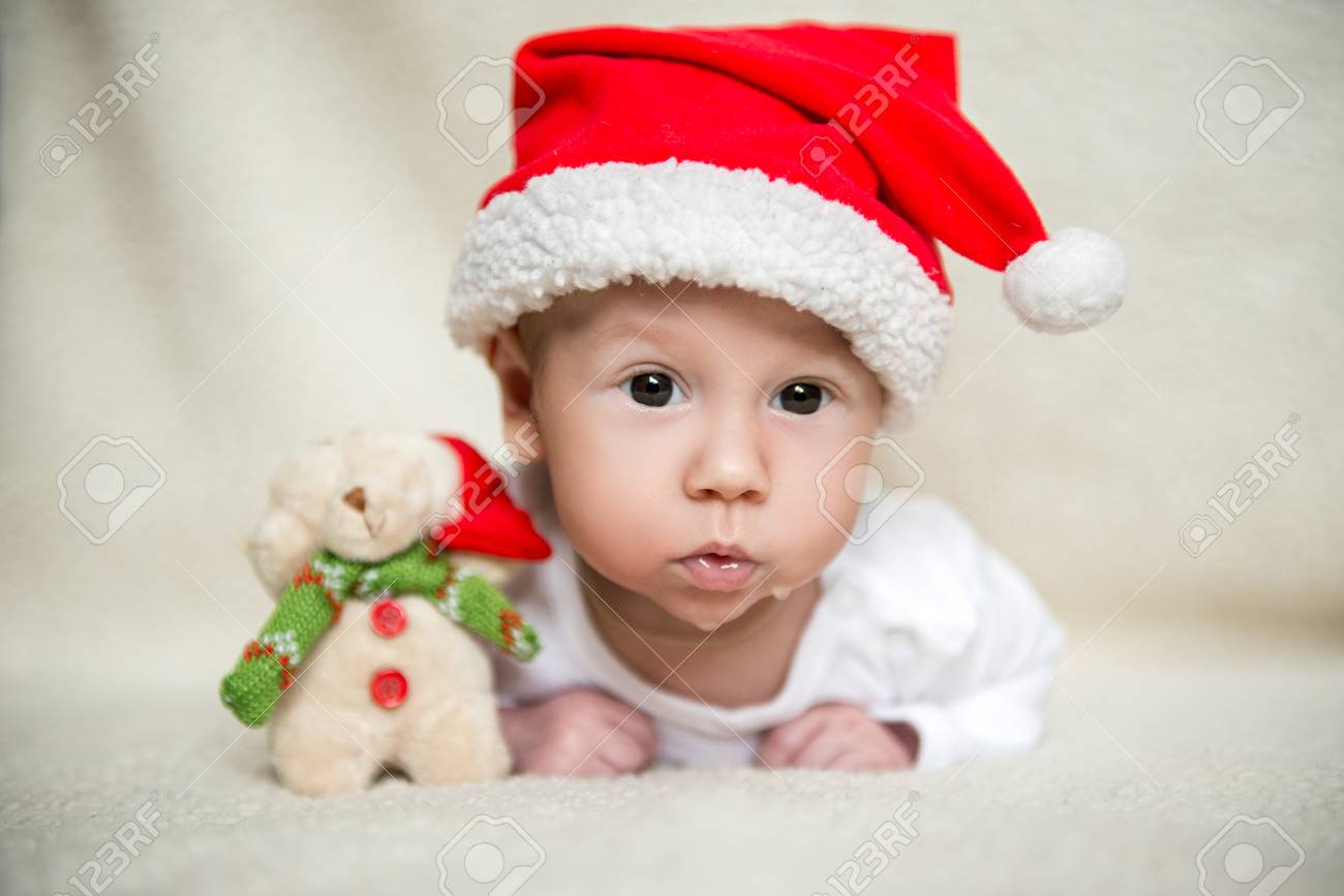 Little baby in red cap of santa claus celebrates christmas christmas photo of infant in