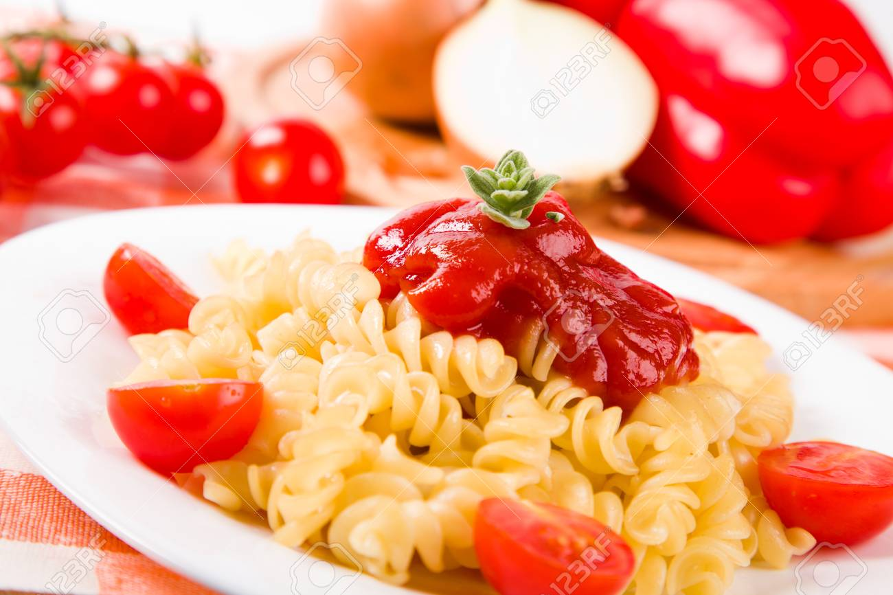 cooced makaroni on plate with vegetables Stock Photo - 11882455