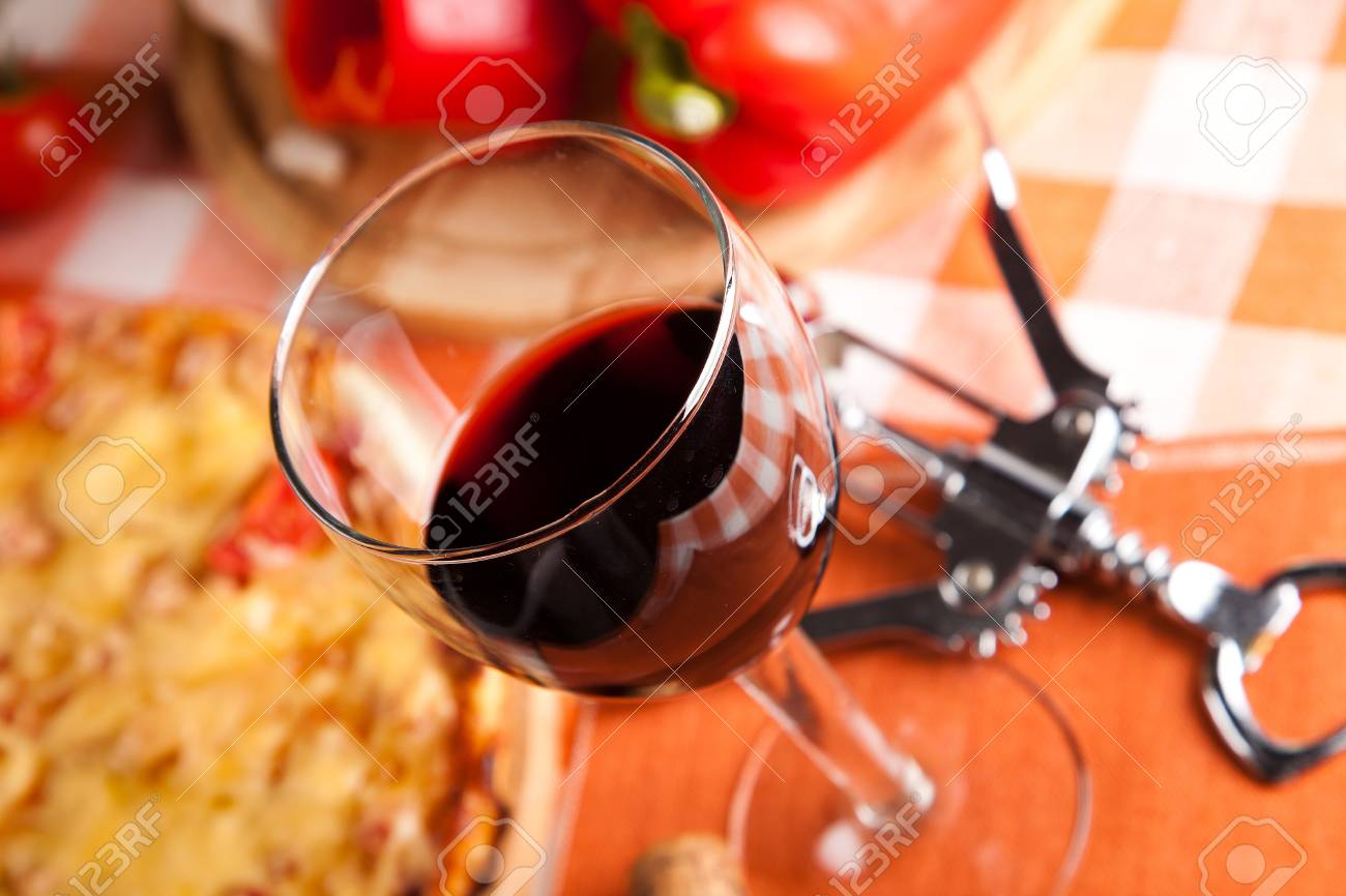 glass of red wine and food Stock Photo - 12185587