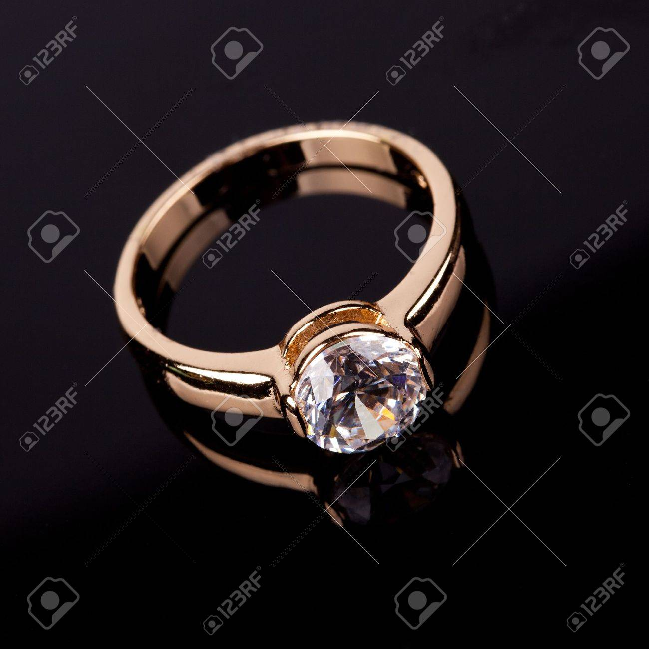 wedding ring with stone on black backrground Stock Photo - 12603935