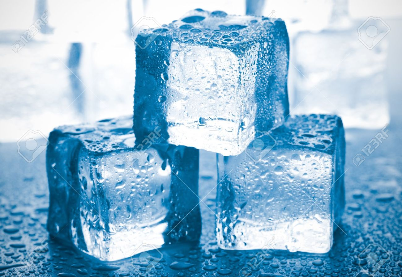 Melting Ice Cubes On Glass Table Stock Photo Picture And Royalty