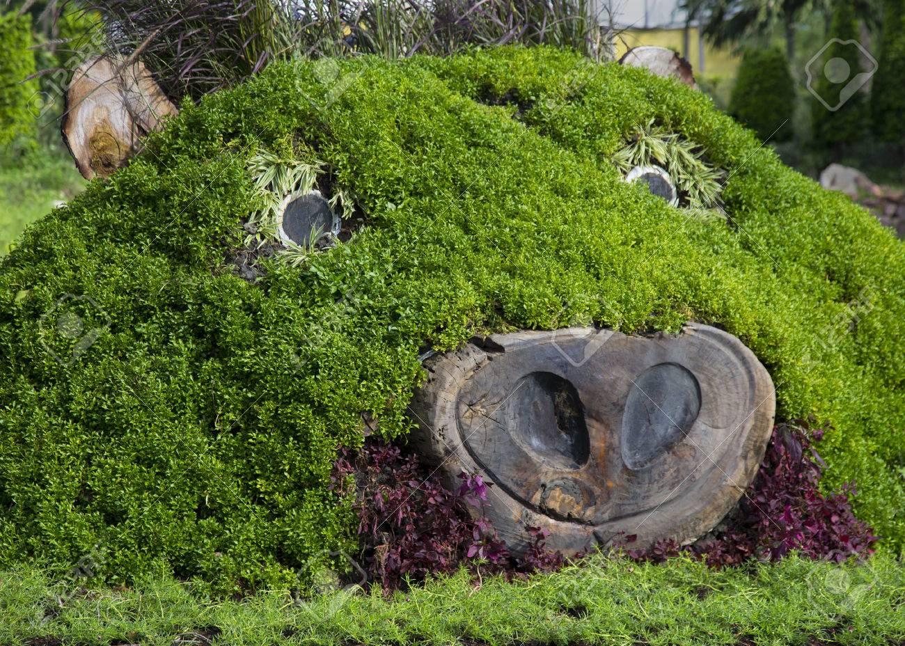 Stock photo pig head shape garden grass hill design