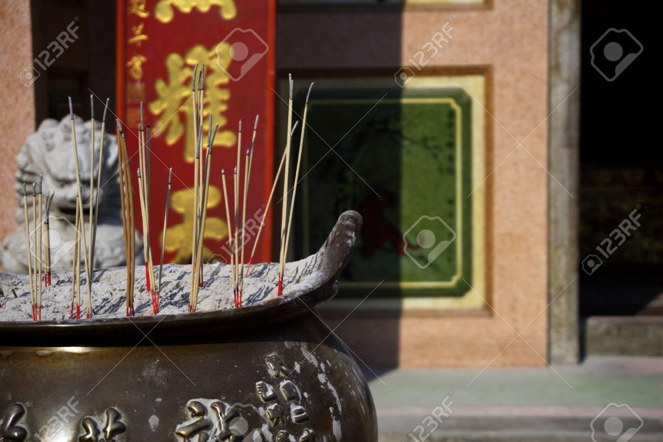 Close up incense burner with incense sticks pray and show respect