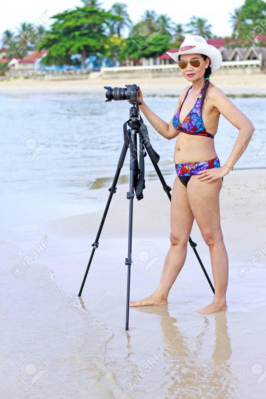 Stock Photo - Women bikini shape sexy with camera on Thung Wua Lan Beach,  at Chumphon Province Thailand.