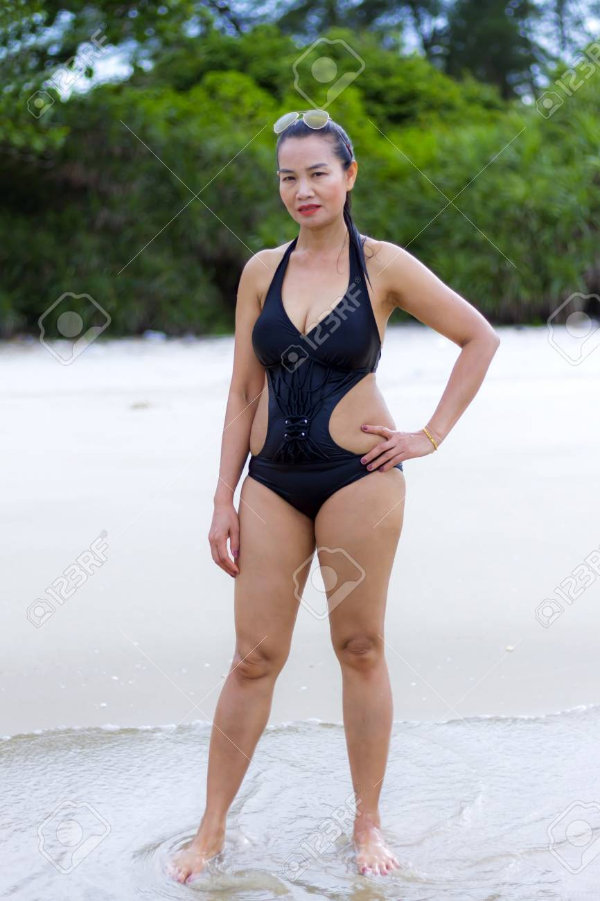45fe5f91c44 Stock Photo - Woman black bikini show shape sexy on beach at Ban Krut Beach,  Prachuap Khirikhan Province Thailand