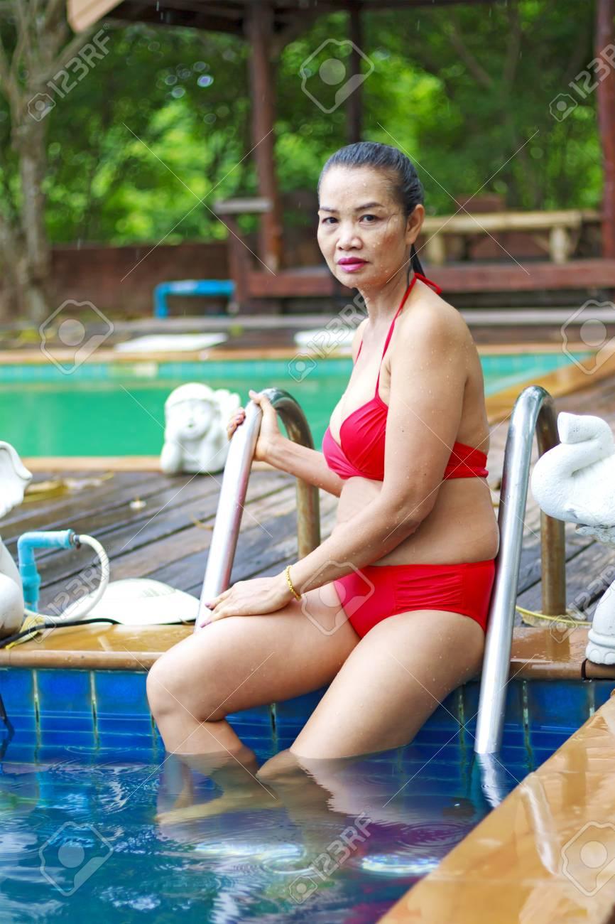 Beach Girl Sex woman sex symbol with red bikini at swimming pool on beach at..