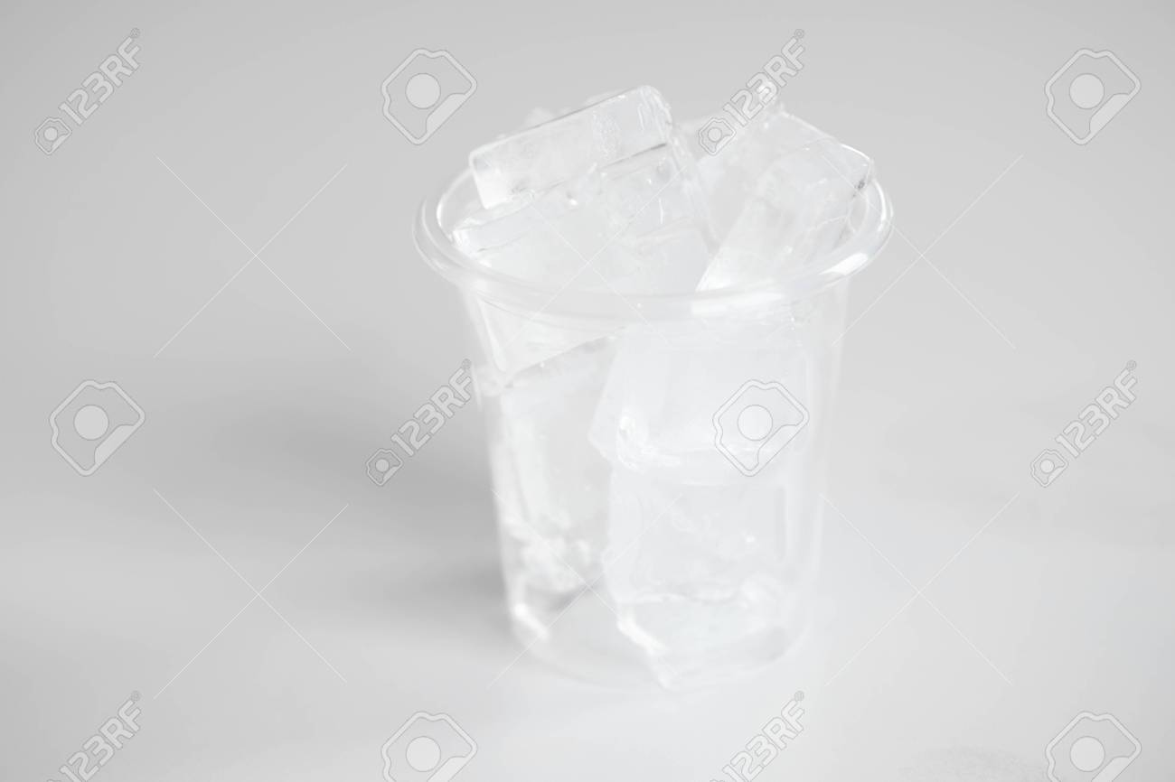 plastic cups with ice cubes