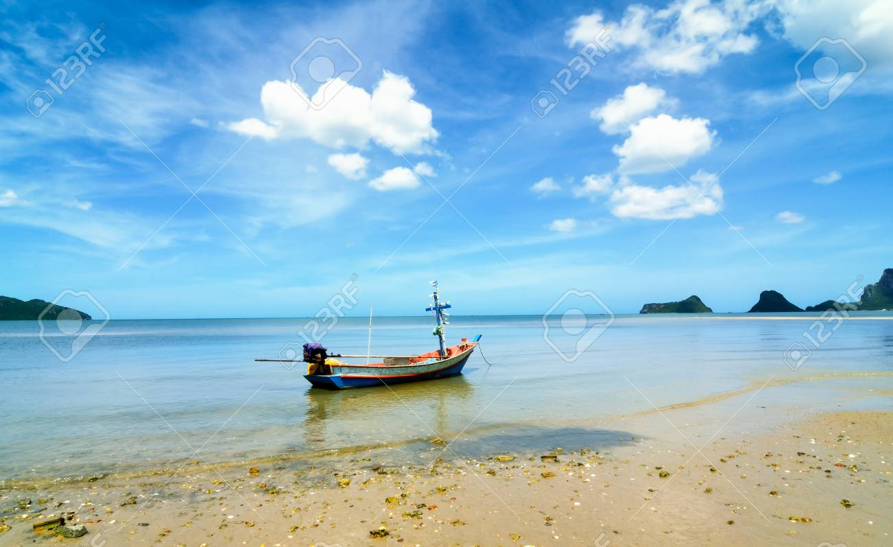 Beach and a fishing boat Stock Photo - 24055253