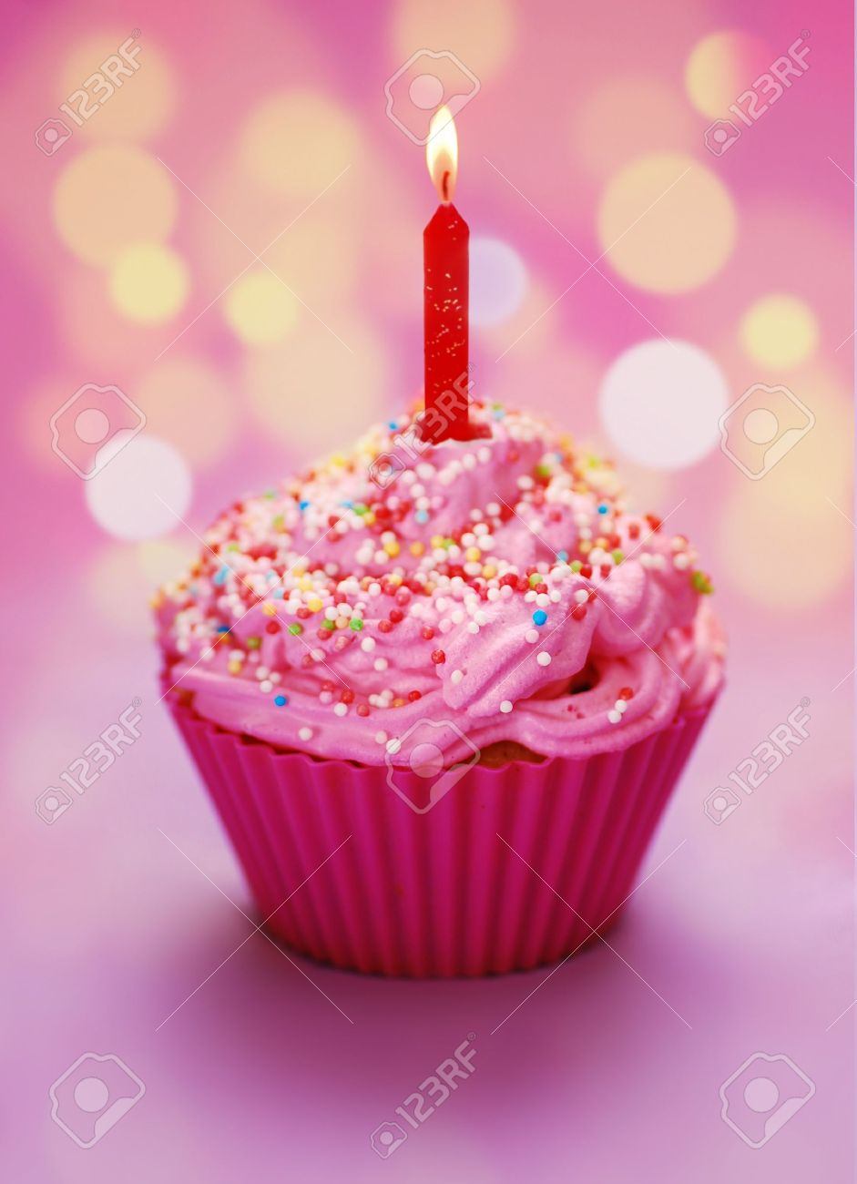 Pink birthday cupcake with a candle Stock Photo - 7977550