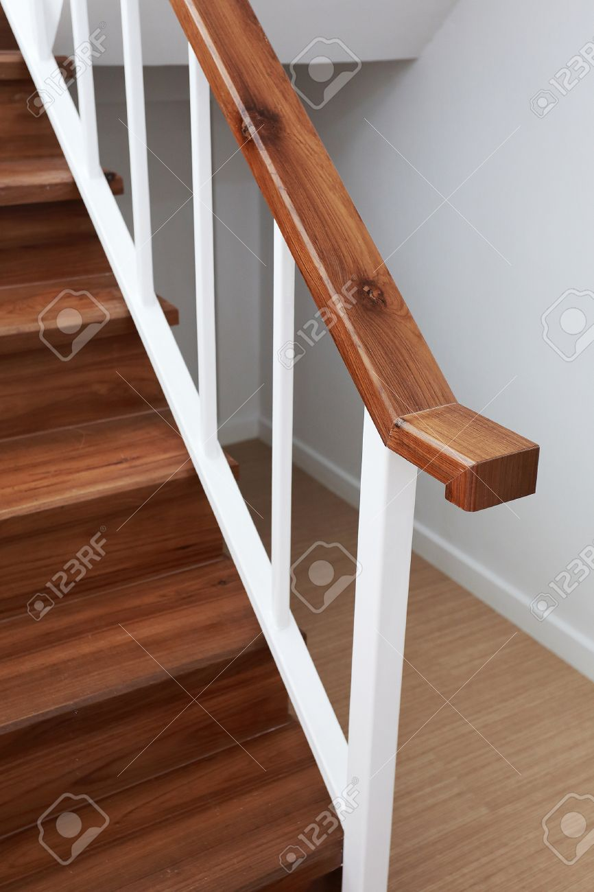 Wooden Staircase Railing In A White Modern House Stock Photo   28910375