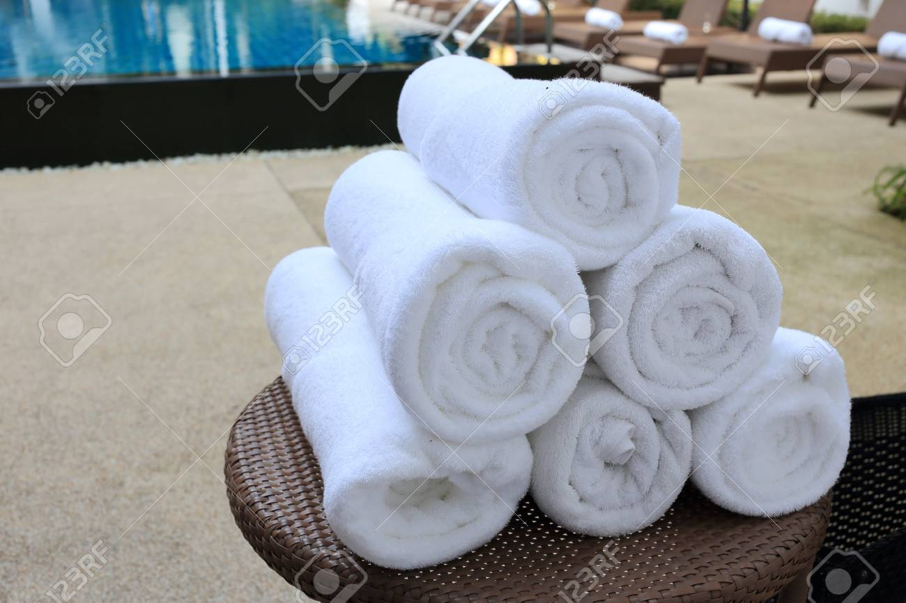 rolled towels at swimming pool