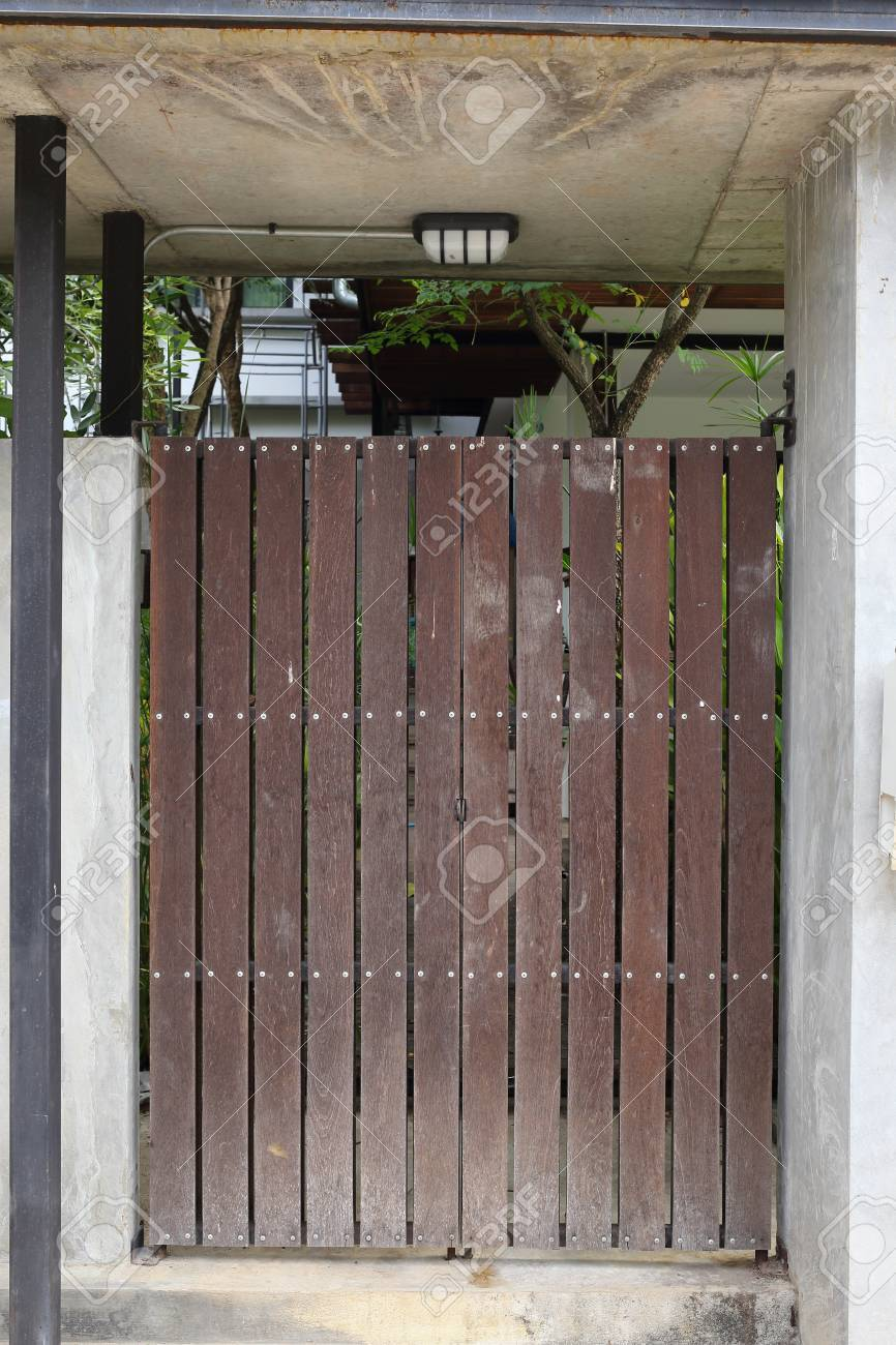 Wood Brown Door Front Gate In Modern House Stock Photo Picture And