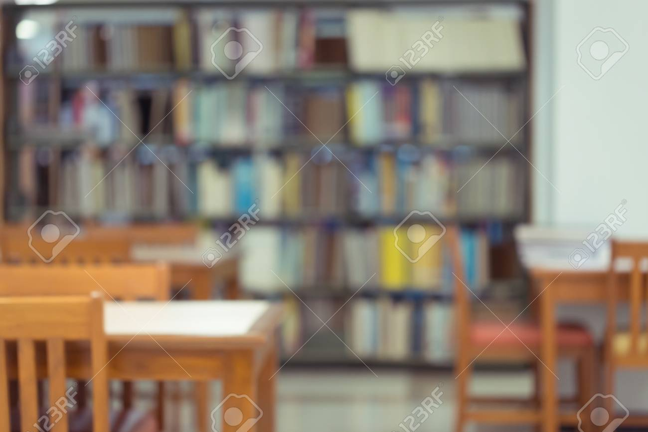 Bookshelf And Table Desk In Library Education Abstract Blur