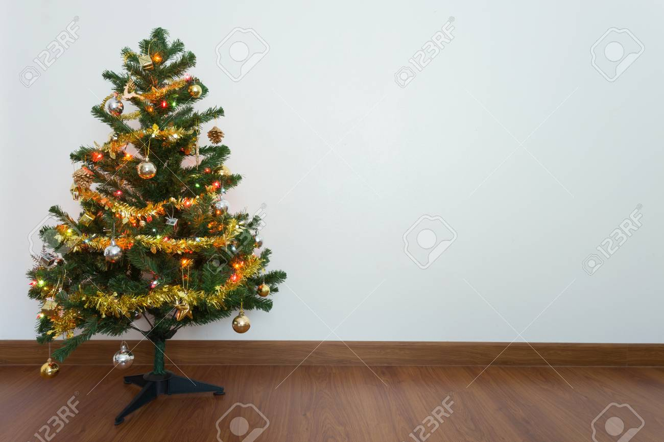 Christmas Tree Decoration In Empty Room With White Wall And Wooden Stock Photo Picture And Royalty Free Image Image 50501305