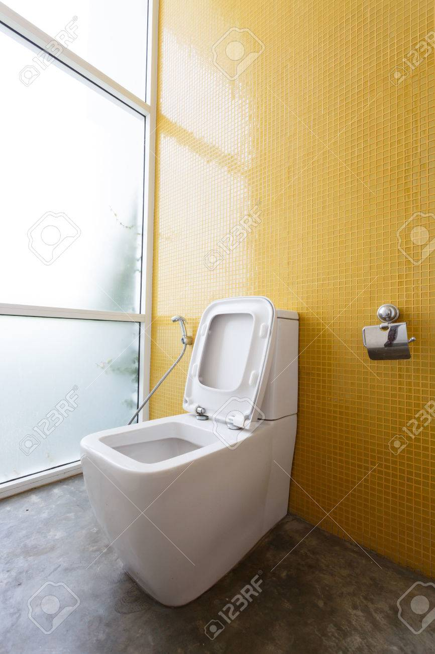 White Flush Toilet And Yellow Wall Mosaic Decoration In Modern ...