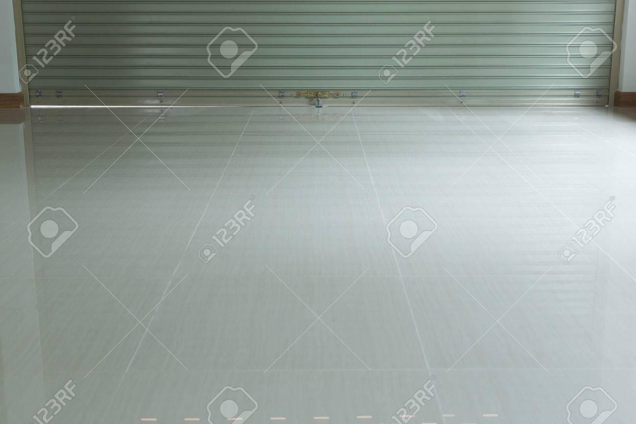 Steel metal door roller shutter door and tile floor in warehouse steel metal door roller shutter door and tile floor in warehouse building stock photo doublecrazyfo Images