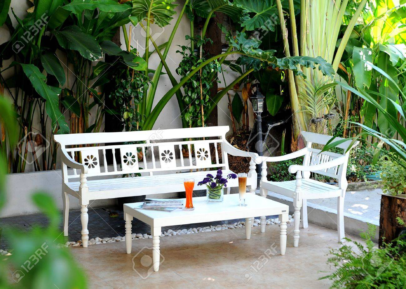 garden furniture a telephoto of white garden table and chairs