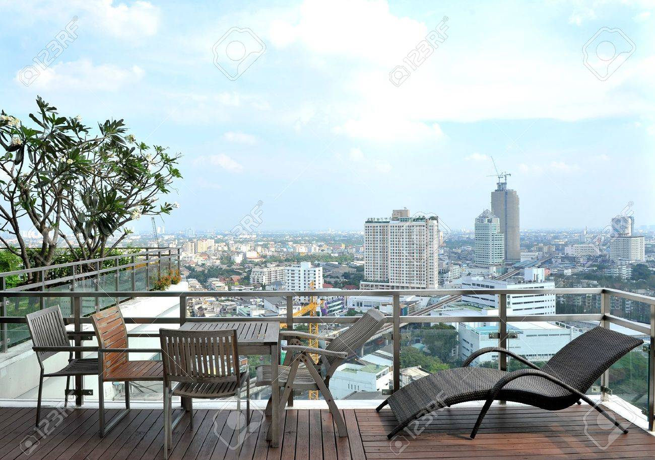 Armchairs and a table on an open terrace Stock Photo - 10545301