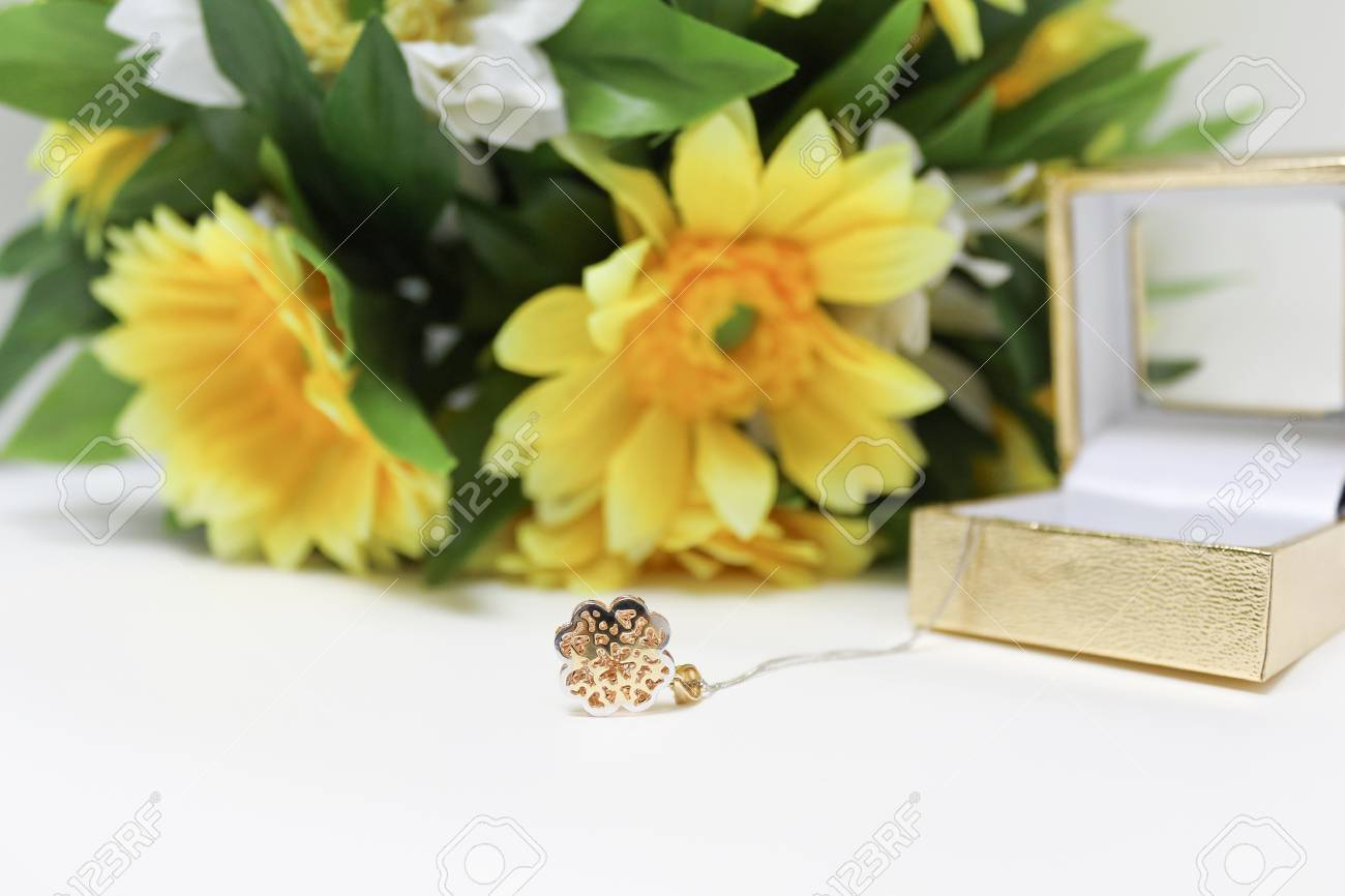 Pink Gold And Sunflower On White Background Stock Photo Picture And