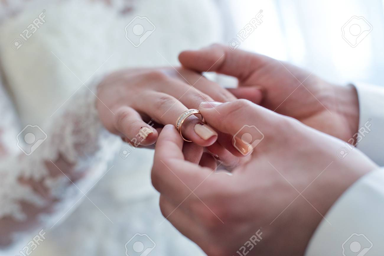 He Put The Wedding Ring On Her Wedding Rings Hands Stock Photo
