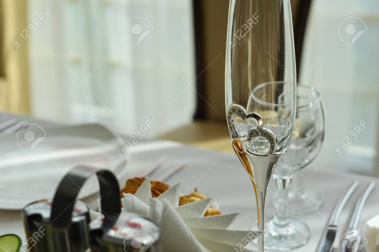 Wedding Table Setting In Restaurant: Nametags, Chairs, Wine Glass ...