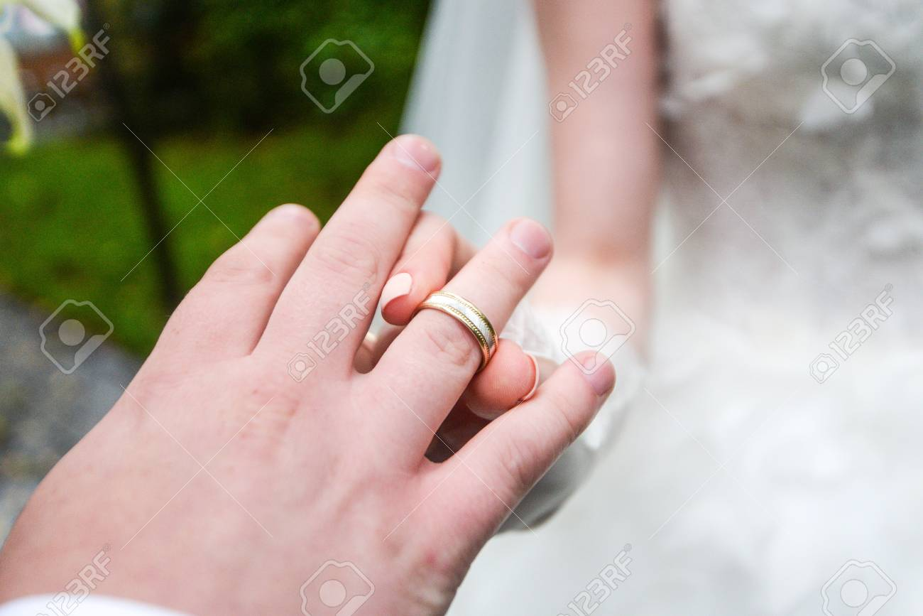 Birde Wears The Ring On The Finger Of The Groom Stock Photo, Picture ...