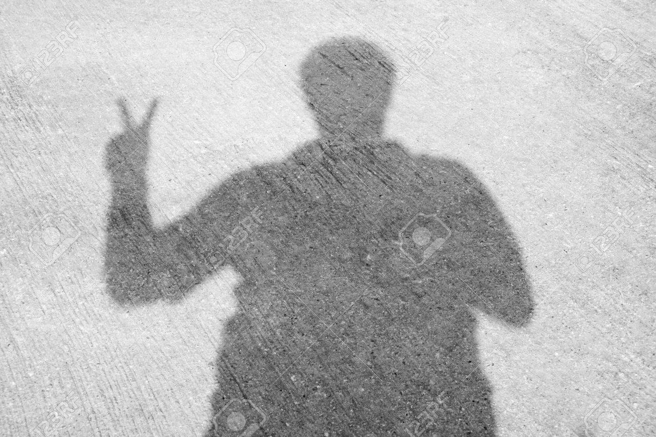 [Image: 32844138-The-peace-sign-shadow-Stock-Photo.jpg]