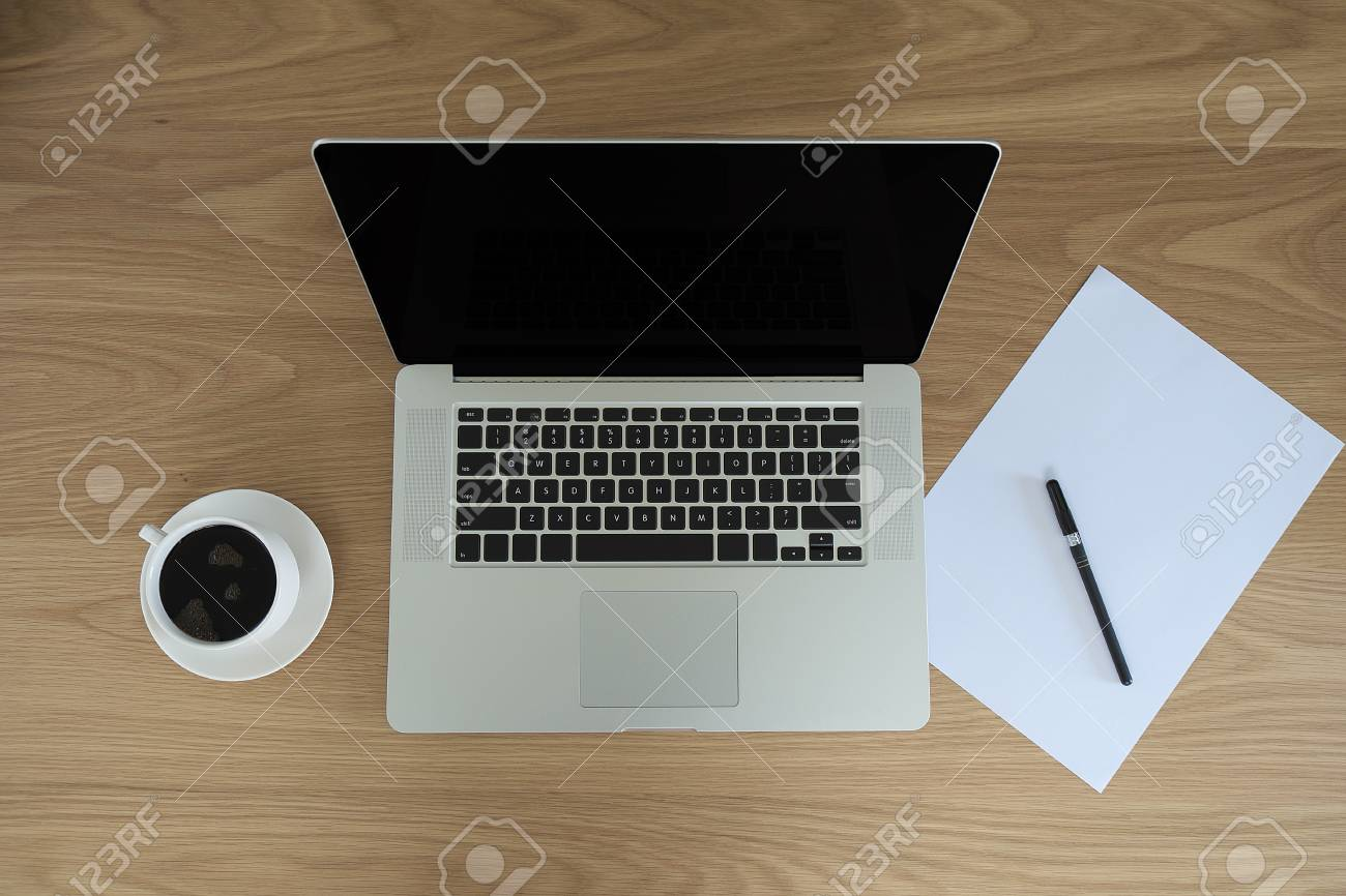 A Cup Of Coffee With Laptop Pen Paper On Desk Background In Stock Photo Picture And Royalty Free Image Image 82740188