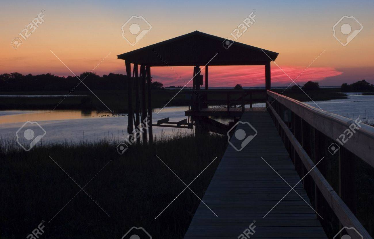 Sunset at the boat house on Cedar Key, Florida. Stock Photo - 572984