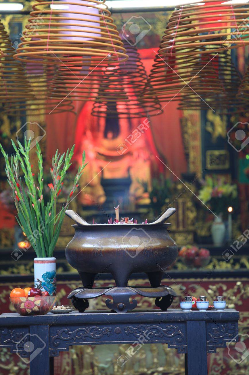 Buddhist prayer joss sticks in a chinese temple Stock Photo - 18777090