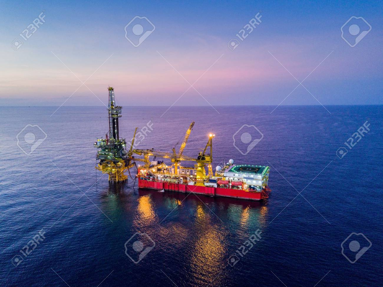 Aerial View of Tender Drilling Oil Rig (Barge Oil Rig) in The Middle of The Ocean at Surise Time - 87397793