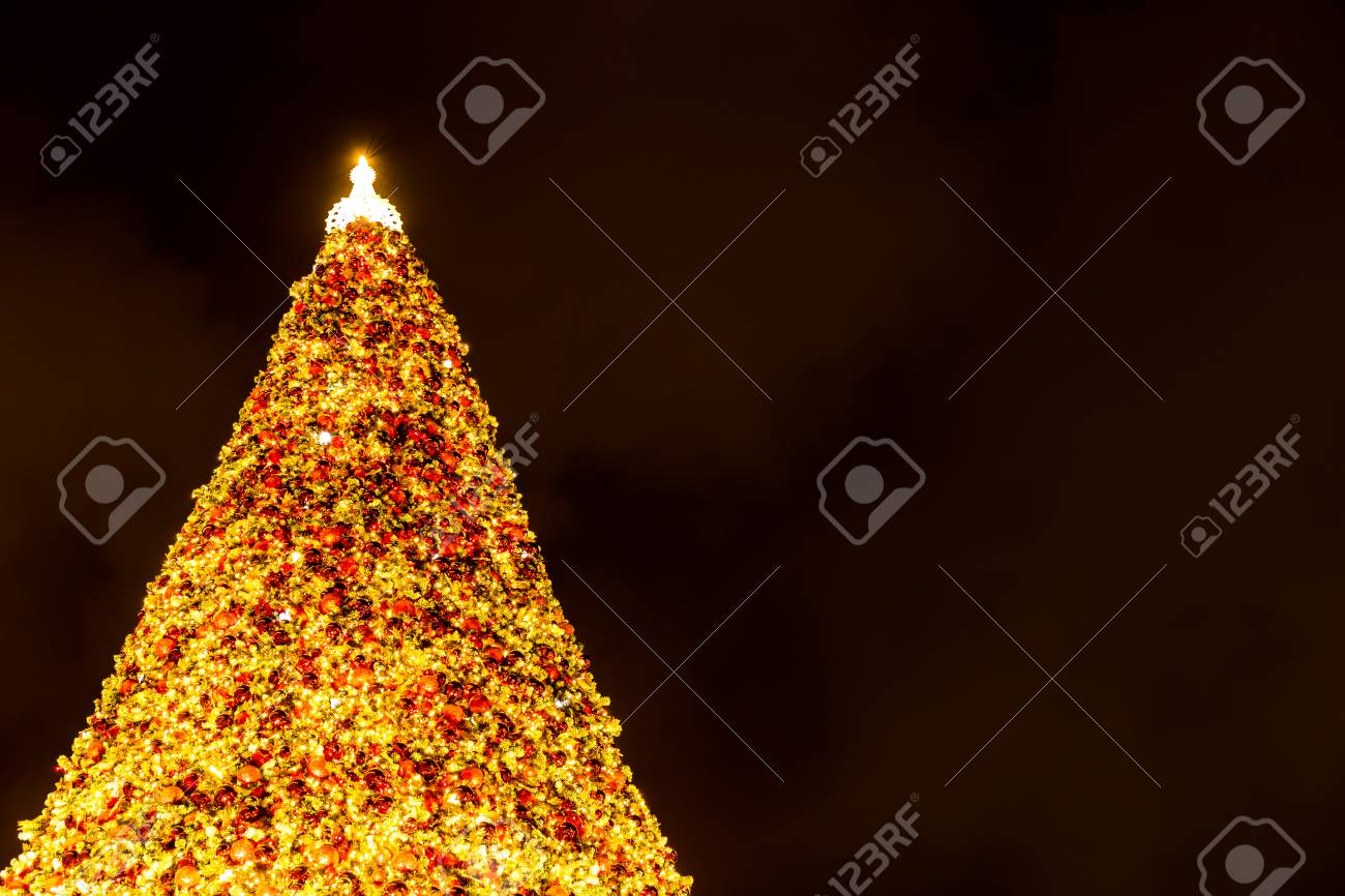 big christmas decorated pine tree close up white lights christmas decorations are lights and