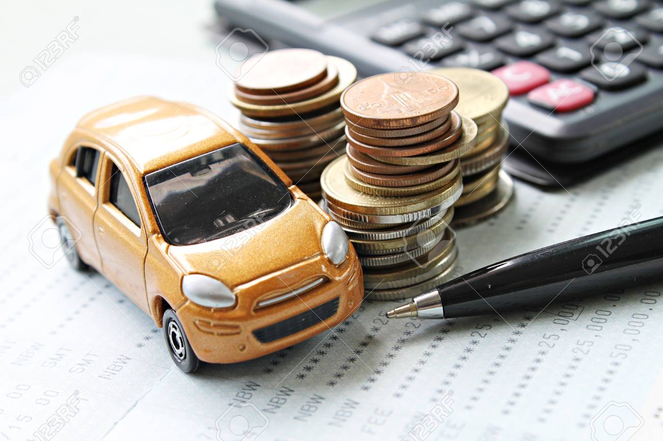 Business, finance, saving money or car loan concept : Miniature car model, coins stack, calculator and saving account book or financial statement on desk table - 88327269