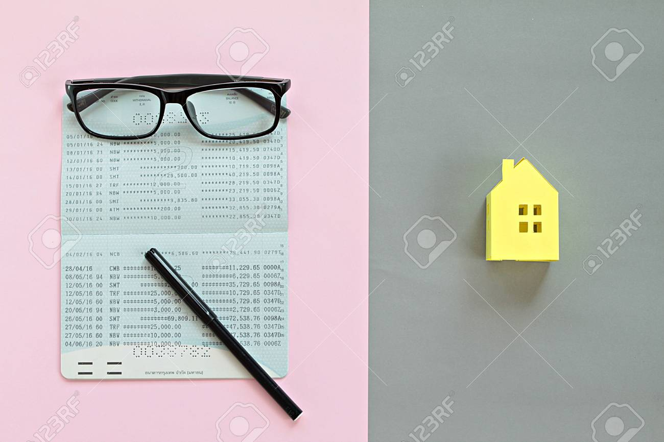 Business, finance, saving money, property ladder or mortgage concept : Top view or flat lay of savings account passbook and yellow paper house model on background - 126599873