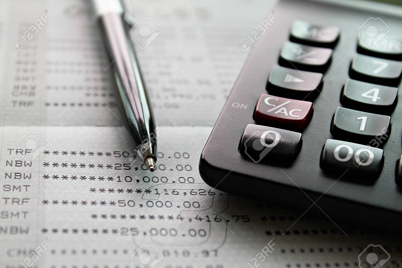 Business, finance, investment, accounting or taxes concept : Top view or flat lay of calculator and pen on savings account passbook or financial statement - 126599890