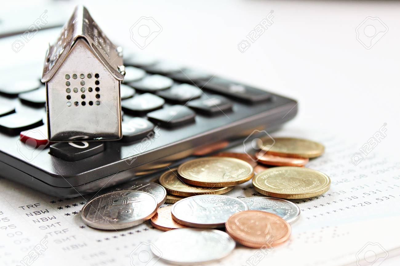 Business, finance, saving money, property ladder or mortgage loan concept : House model, calculator and coins on savings account passbook or financial statements - 126599899