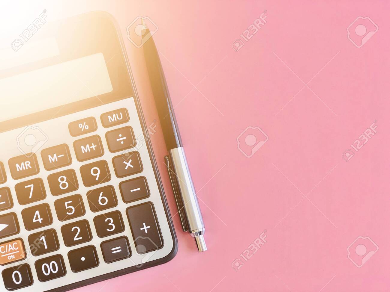 Business, finance, savings money, investment, taxes, money planning or accounting concept : Top view or flat lay of calculator and pen on pink background with copy space ready for adding or mock up - 134868456