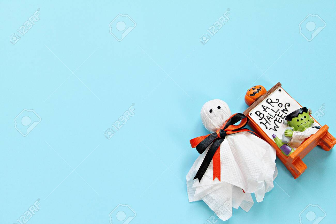 Halloween holiday background concept : Top view or flat lay of Halloween decoration with ghost on blue background with copy space, ready for adding or mock up - 136971391