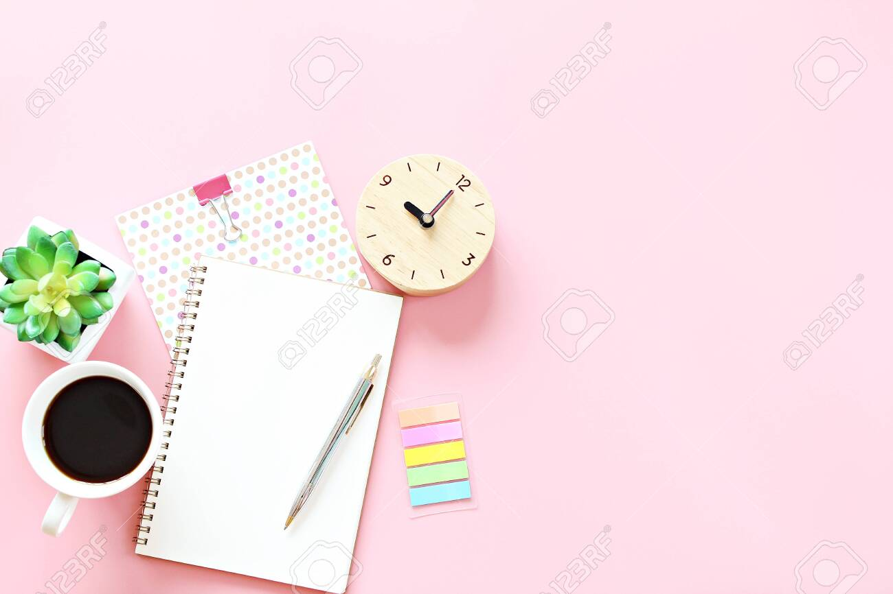 Still life, business, office supplies, working day, meeting, education, work from home concept : Notebook, clock, pen and coffee cup on pink background with copy space ready for adding or mock up - 144570955