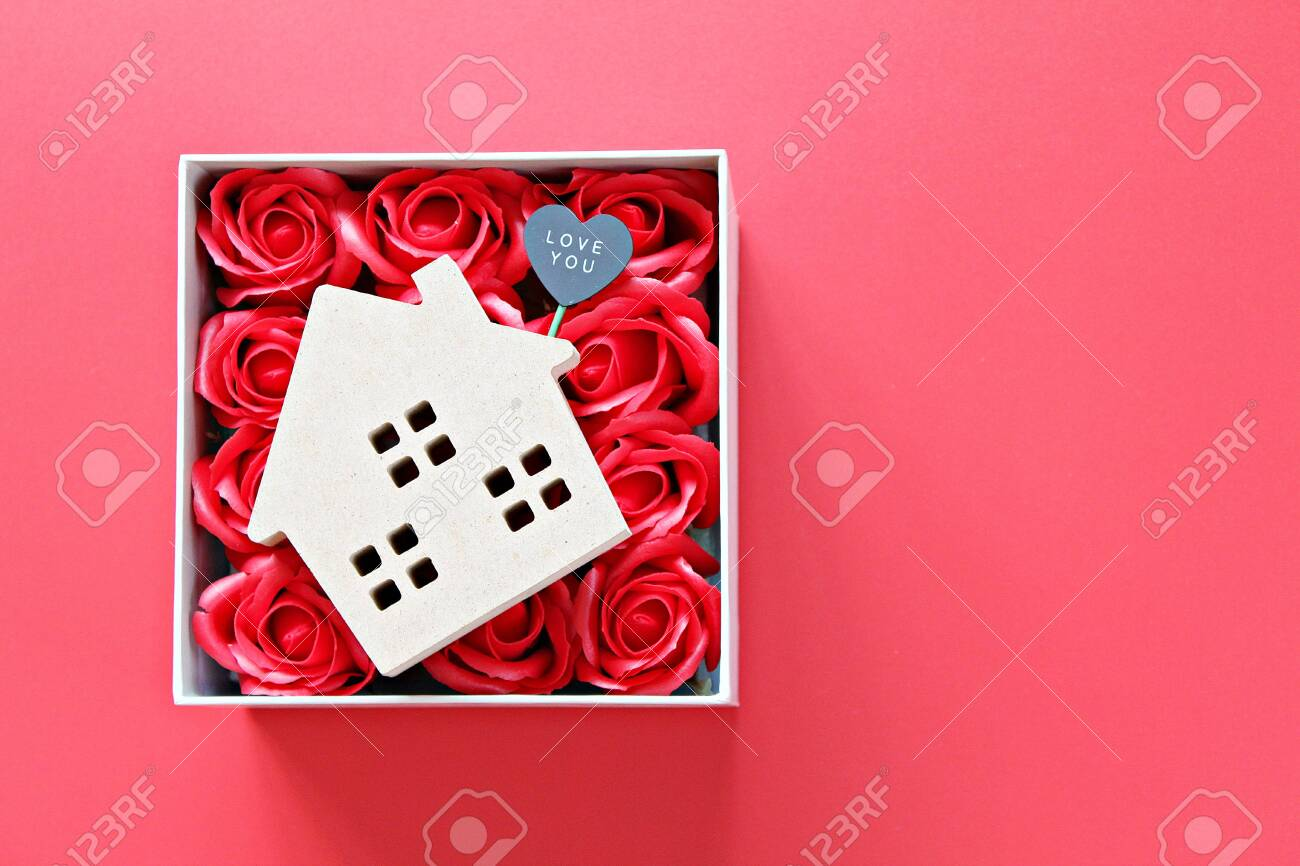 Business, finance, property ladder, mortgage loan, love, gifts or Valentine's day concept : Wood house model with love you tag and red roses on red background with copy space for adding or mock up - 140001967