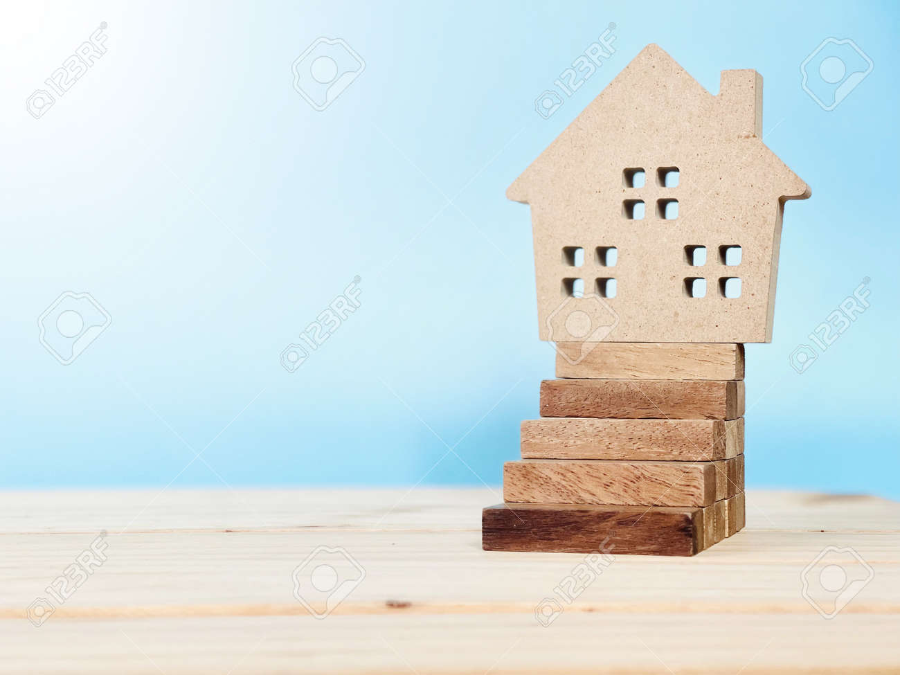 Wood house model on wood block stacking as step stair - 168796805