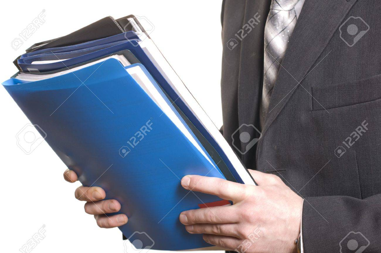 business man holding stack of files and folders Stock Photo - 7127394