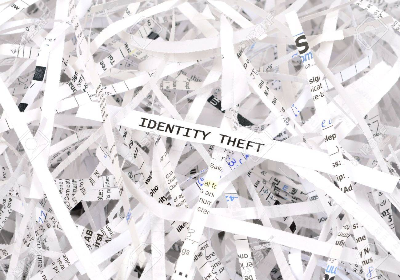 Identity theft text surrounded by shredded paper. Great concept for information protection Stock Photo - 4639118