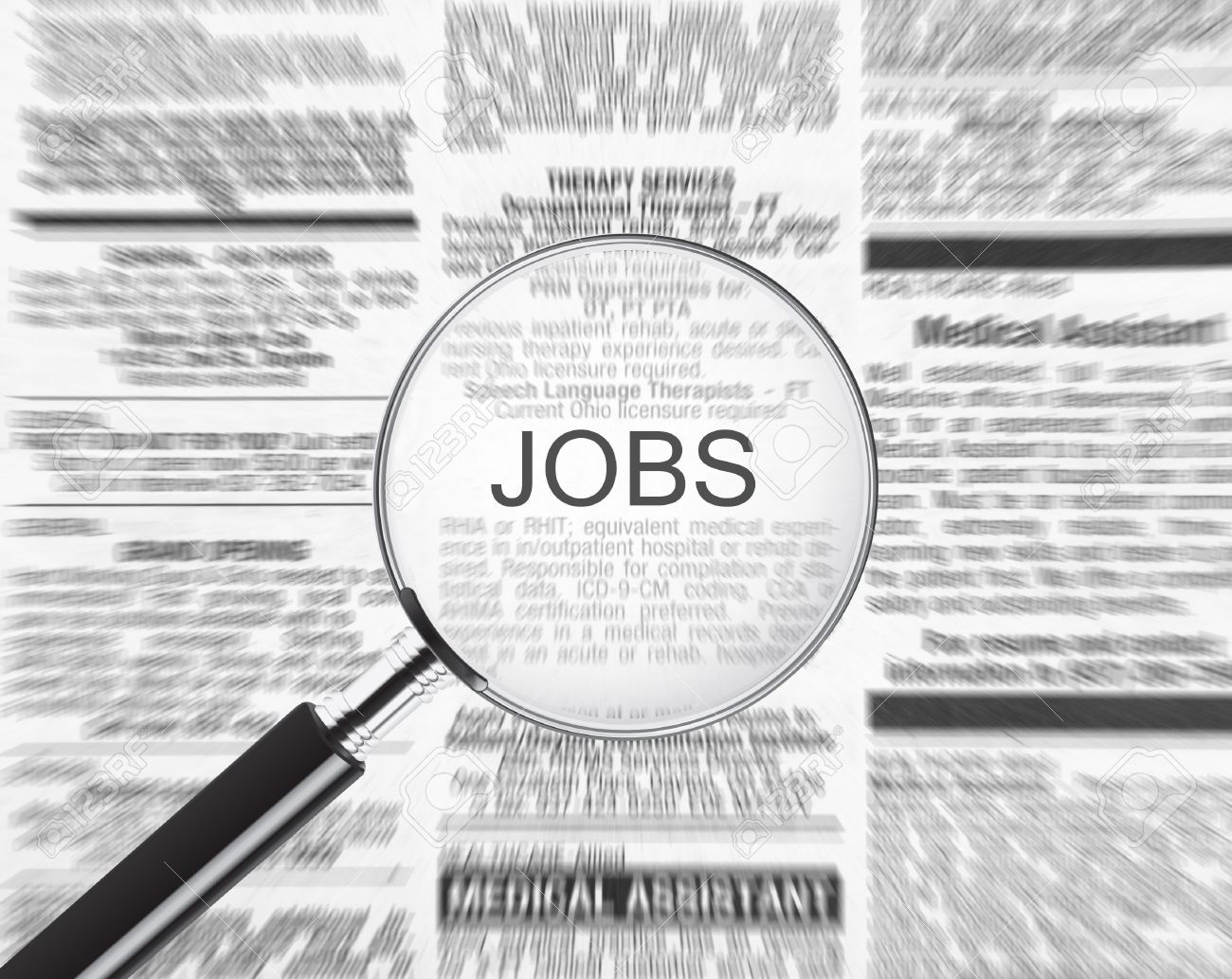 Jobs ad in a newspaper through a magnifying glass Stock Photo - 6406796