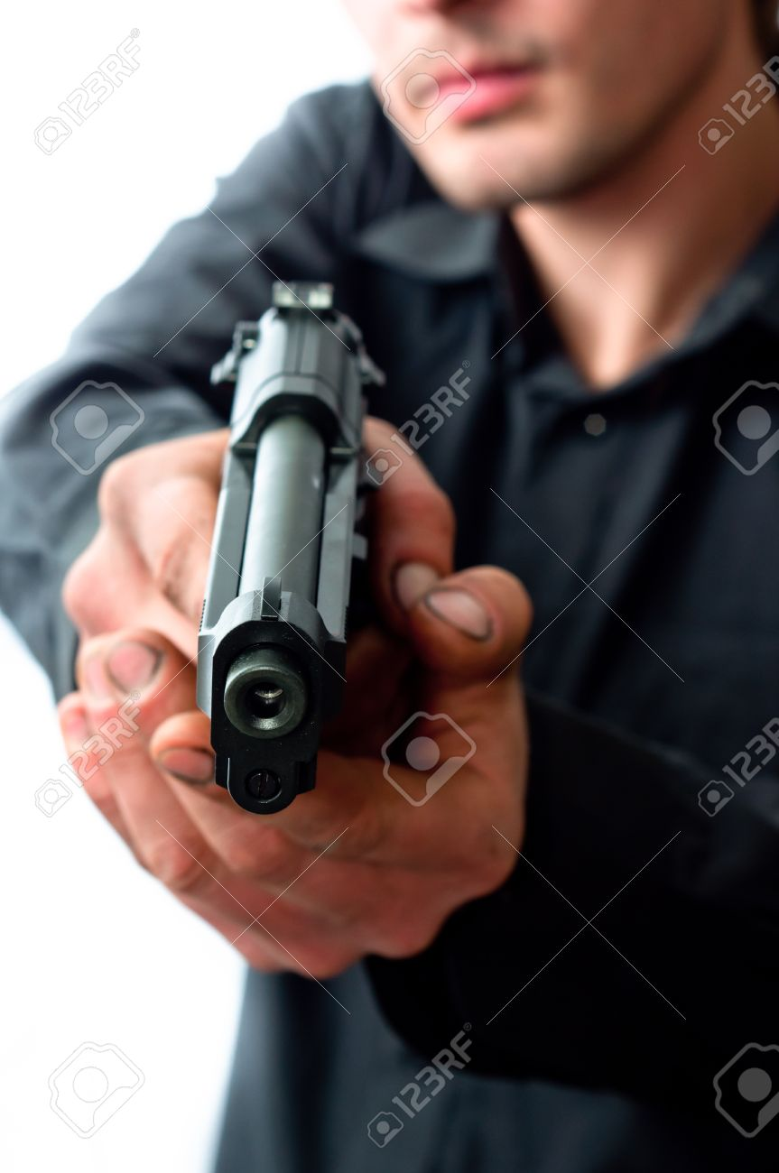 Man with gun focus on pistol with dirty hands Stock Photo - 9473703