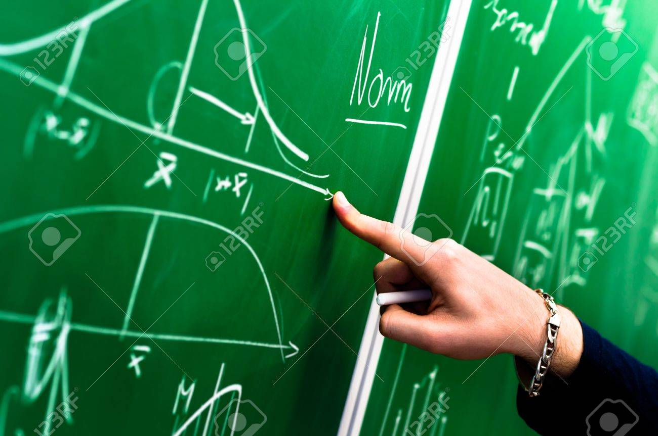 Hand of a student pointing at green chalk board Stock Photo - 9485555