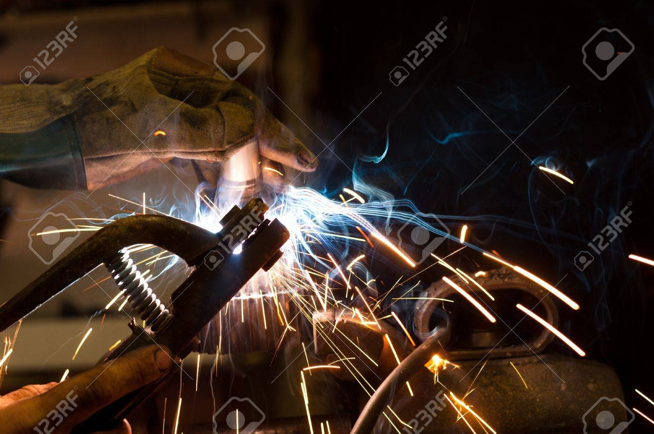 worker welding steel with white sparks Stock Photo - 9485532