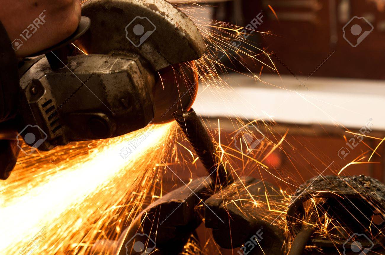 Close up of a metal sawing machine with sparks Stock Photo - 9486415